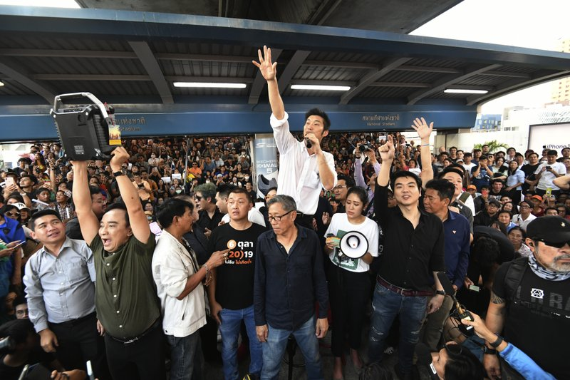 FILE - In this Dec. 14, 2019, file photo, Thailand's Future Forward Party leader Thanathorn Juangroongruangkit talks to his supporters during rally in Bangkok, Thailand. A statement from Thailand's Constitutional Court says it will rule on a sedition case against the popular Future Forward Party that links it to what conspiracy theorists call the Illuminati,