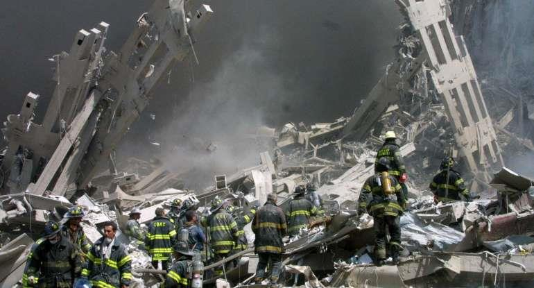 Firefighters make their way through the rubble after two airliners crashed into the World Trade Center in New York bringing down the landmark buildings Tuesday, Sept. 11, 2001.