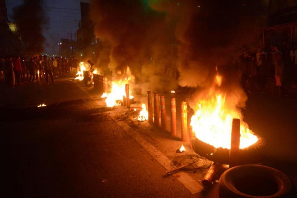 Protesters burned tires in the streets of Guwahati, India, on Wednesday as India's upper house of legislators passed a bill granting citizenship to non-Muslim illegal immigrants.