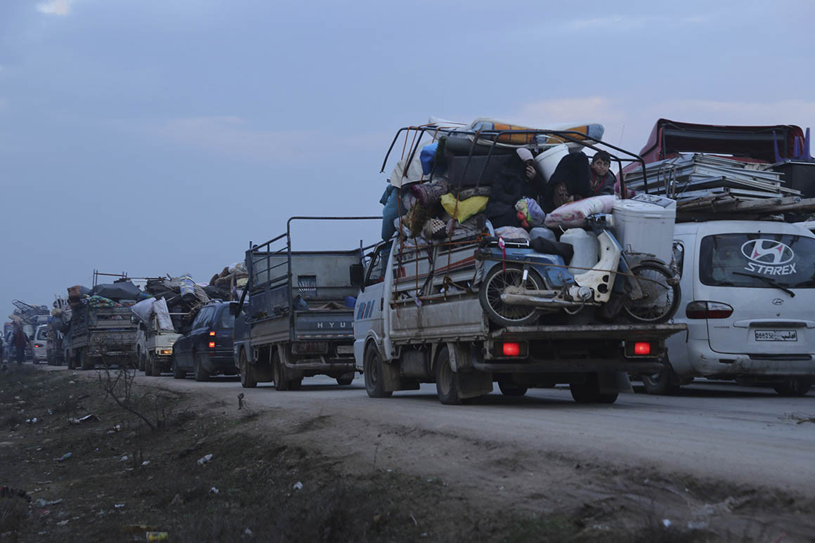 Truckloads of civilians flee a Syrian military offensive in Idlib province on the main road near Hazano, Syria on Tuesday.