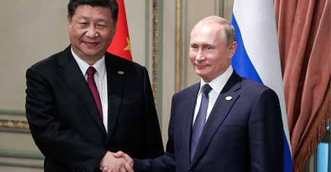 In Buenos Aires, Argentina, on November 30, 2018, China's President Xi Jinping, left, shakes hands with Russia's President Vladimir Putin during a bilateral meeting on the sidelines of the G20 Leaders' Summit.