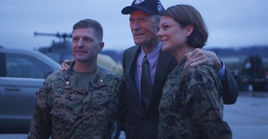 U.S. Marine Corps Maj. Matthew Hilton, Director of the Entertainment Media Liaison Office, Communication Directorate, and U.S. Marine Corps Master Sgt. Kristin Bagley, Communication Strategy and Operations Chief for the Entertainment Media Liaison Office, Communication Directorate meet and greet with Clint Eastwood,