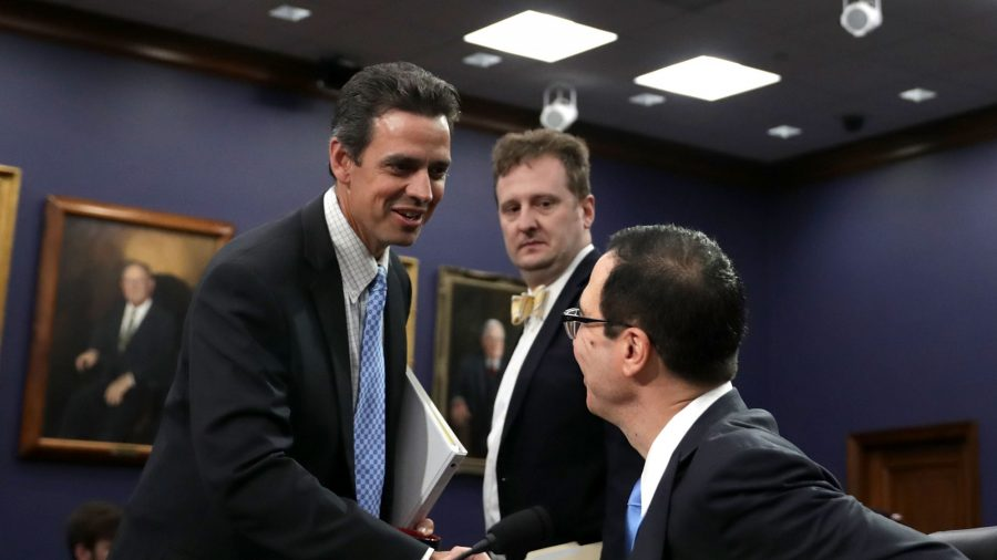 (L) Tom Graves (R-Ga.) greets Treasury Secretary Steven Mnuchin before a hearing in the Rayburn House Office Building on Capitol Hill in Washington on June 12, 2017.