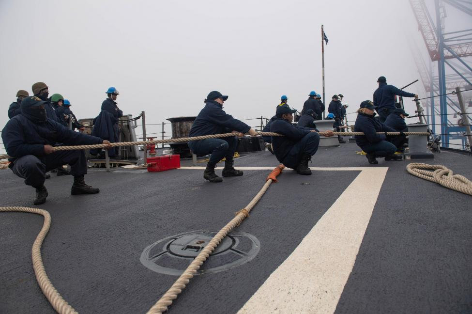 Sailors assigned to the Arleigh Burke-class guided-missile destroyer USS Ross heave in line during a sea and anchor evolution on Dec. 24.