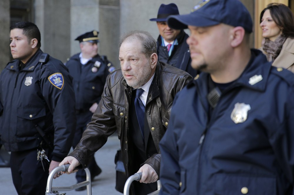 Harvey Weinstein leaves a Manhattan courthouse following jury selection for his trial on rape and sexual assault charges, Friday, Jan. 17, 2020, in New York.