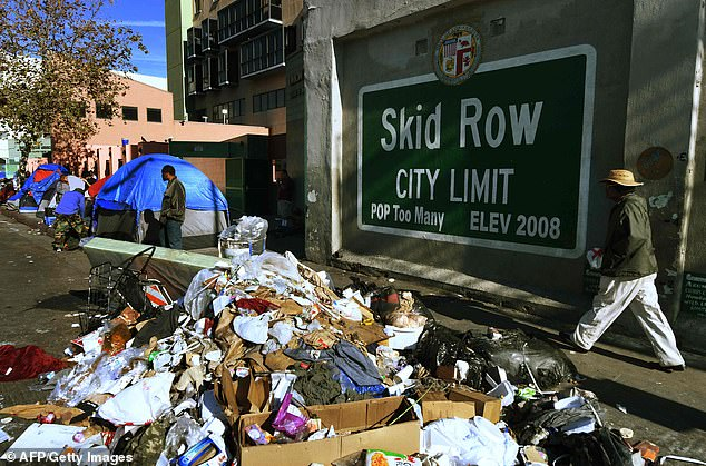 Supporters claim that declaring an emergency would free up state and federal funding reserved for natural disasters, such as earthquakes or wildfires. Trash is seen lining the street of Skid Row, where homeless people have been camping for years .