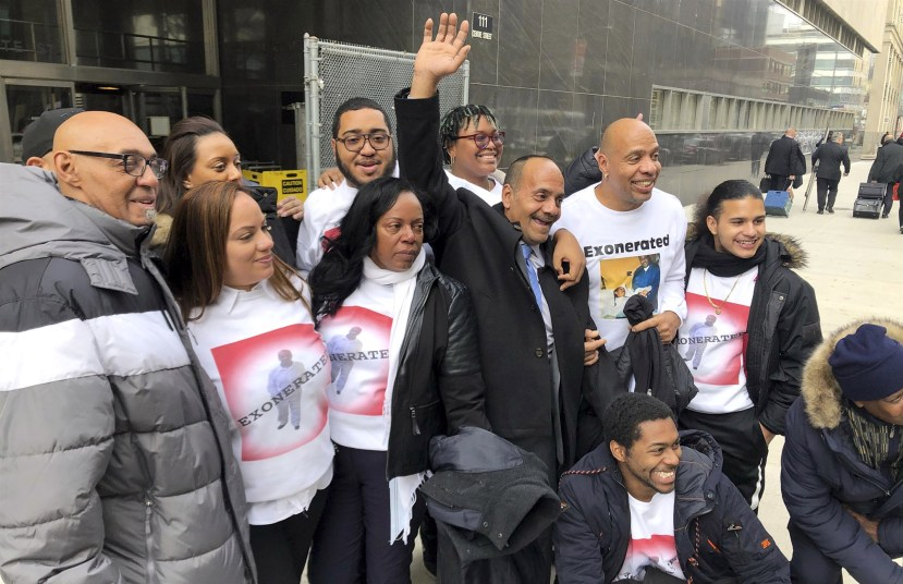 Rafael Ruiz raises his hand outside State Supreme Court in Manhattan after being exonerated of rape on Jan. 28, 2020.