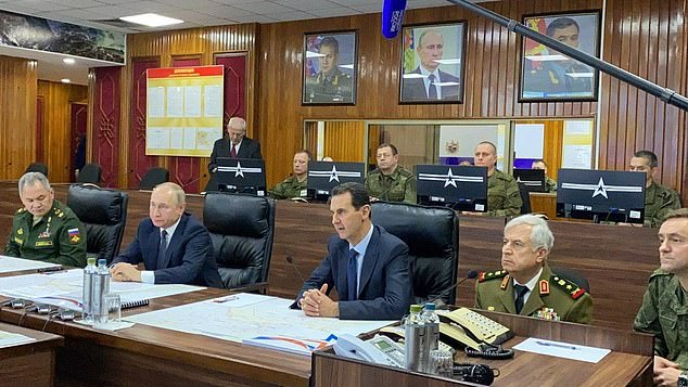 Vladimir Putin visited the headquarters of Russian forces in Syria on Tuesday as he listened to military briefings alongside the country's ruler, Bashar al-Assad
