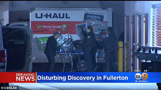 U-Haul workers found the body tightly wrapped in plastic, cardboard and duct tape (pictured on a stretcher)