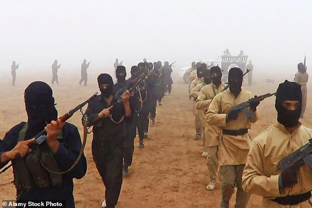 Islamic State of Iraq and the Levant fighters march shown in propaganda photos released by the militants.