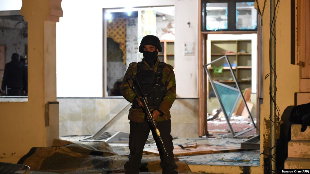 A soldier stands guard at the mosque hit by the bomb blast.
