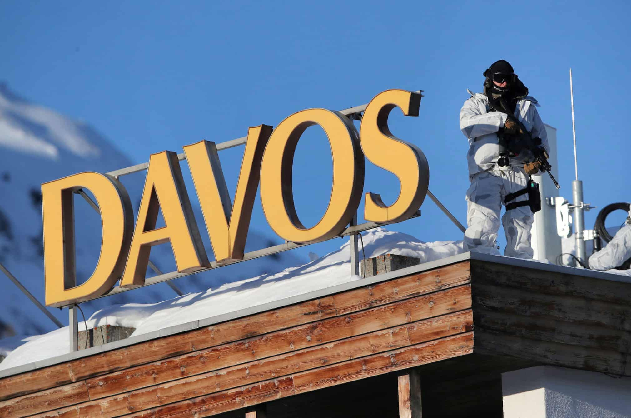 A police officer stands guard ahead of the annual event in Davos