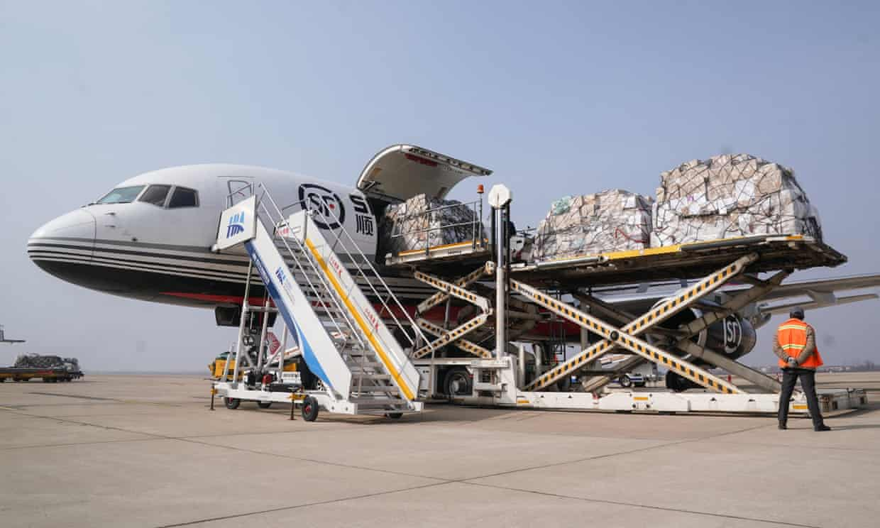 Medical materials are unloaded from a plane at Wuhan airport. Britons have complained they may not get to the airport in time for a chartered flight home.