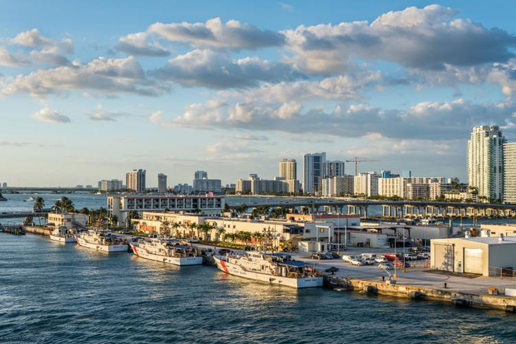 U.S. Coast Guard vessels docked \in Biscayne Bay in the Port of Miami, Florida.  Shutterstock.com