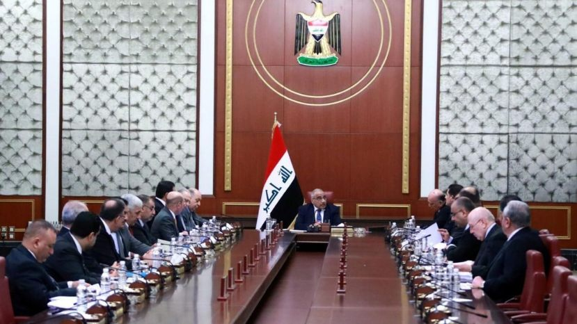 In a photo released by the Iraqi Prime Minister Media Office, Prime Minister Adil Abdul-Mahdi, center, heads a cabinet meeting at the prime minister's office, in Baghdad, Iraq, on Tuesday. Abdul-Mahdi called for American troops to leave the country amid escalating tensions between the U.S. and Iran.