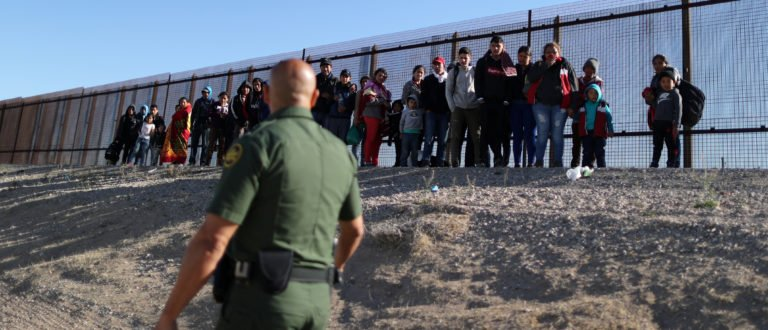 A group of Central American migrants surrenders to U.S. Border Patrol Agent Jose Martinez south of the U.S.-Mexico border fence in El Paso, Texas, U.S., March 6, 2019.