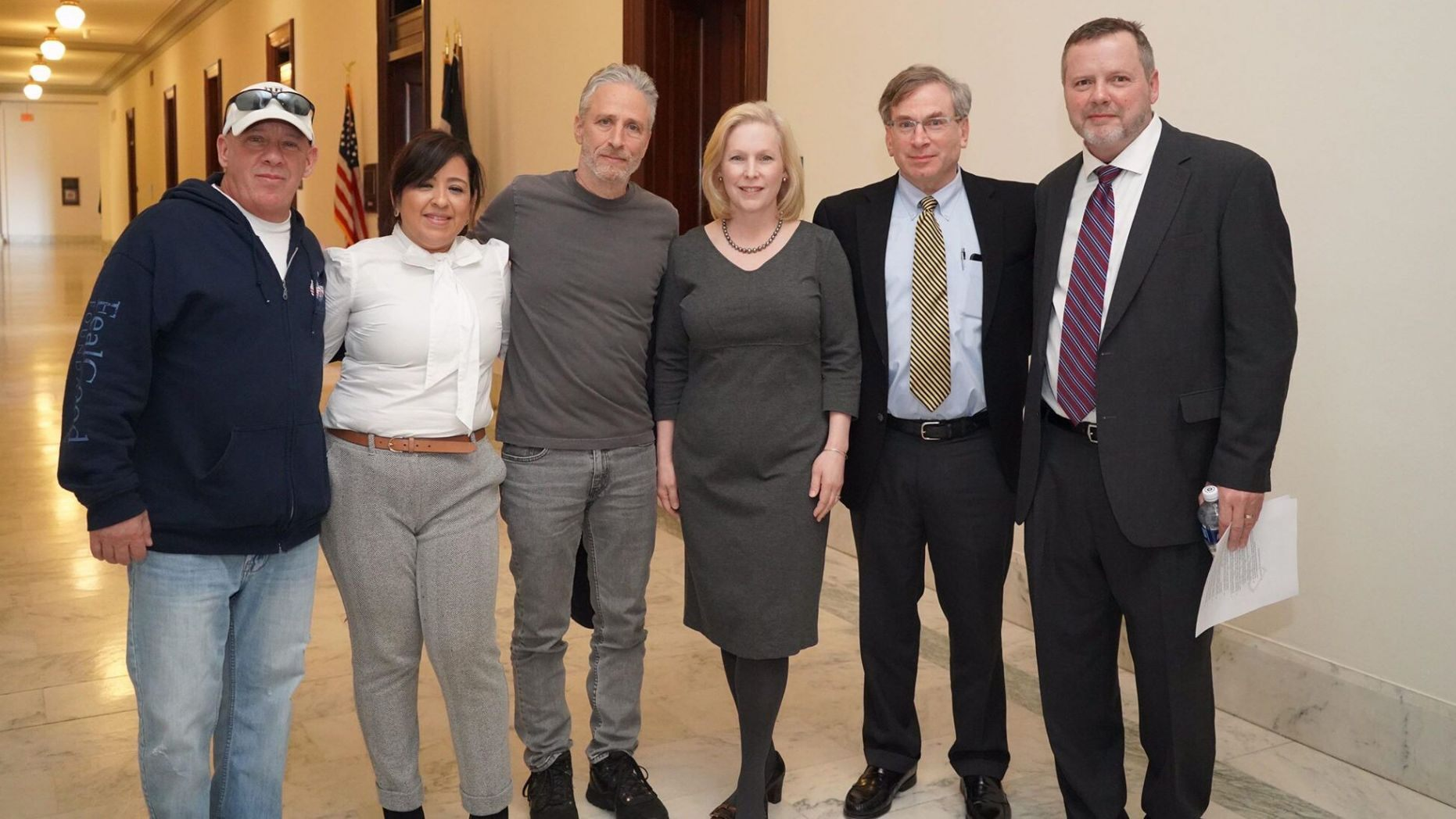 Jon Stewart (center) recently met with Senator Kirsten Gillbrand (D-NY, center) along with advocates John Feal (left) and Rosie Torres (left), founder of Burn Pits 360.