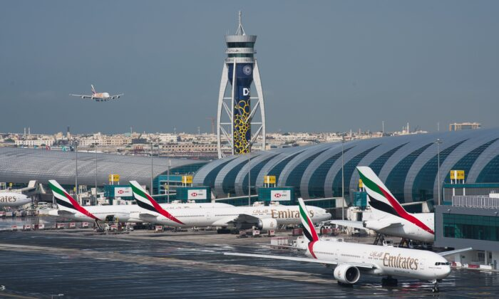 Dubai International Airport, the world's busiest for international travel, said on Jan. 23, 2020, that it is taking special precautions to screen the droves of Chinese tourists expected for the Lunar New Year holiday after the outbreak of a pneumonia-like virus that has led to China's lockdown of the entire city of Wuhan. (Jon Gambrell/AP)
