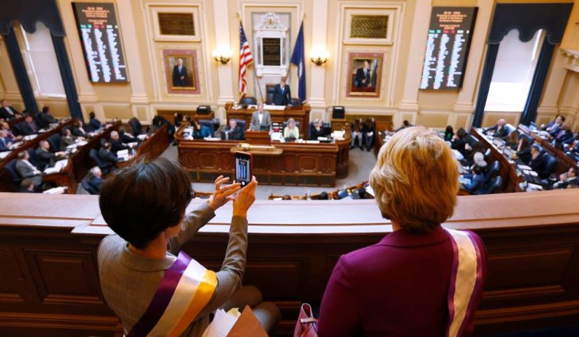 State Sens. Jennifer Boysko, D-Fairfax, left, and Janet Howell, D-Fairfax, watch a vote on a resolution that would bring the Equal Rights Amendment to the floor of the House at the Capitol in Richmond, Va., Thursday, Feb. 21, 2019. The resolution failed.