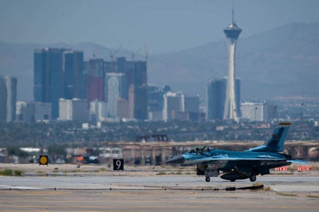 An F-16 Fighting Falcon fighter jet assigned to the 64th Aggressor Squadron (AGRS) taxis onto a runway at Nellis Air Force Base, Nevada, Aug. 8, 2019.