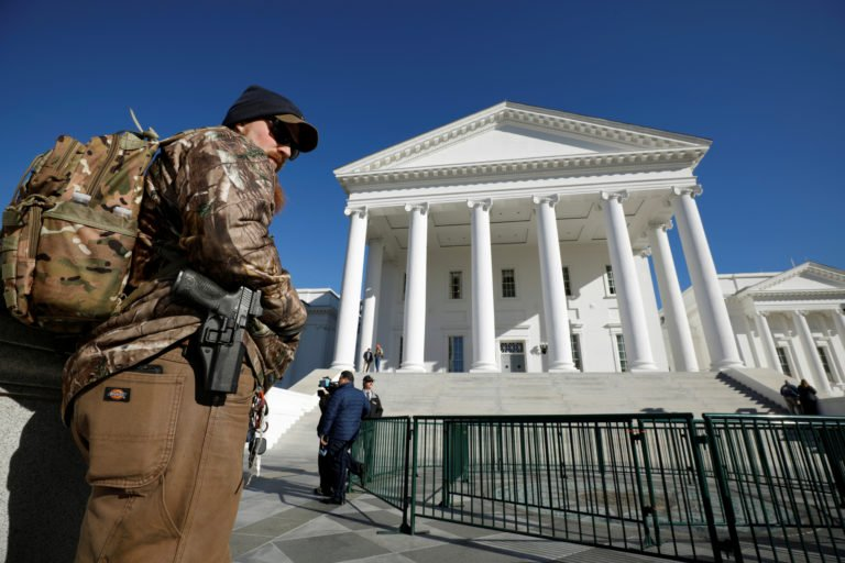 A gun rights activist carries his handgun in a hip holster outside the Virginia State Capitol building as the General Assembly prepares to convene in Richmond, Virginia, U.S. Jan. 8, 2020.