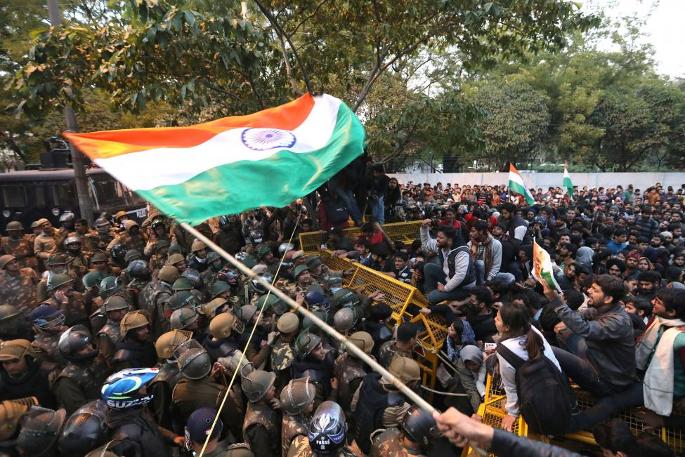 Activists are stopped by Indian security personnel Thursday near Jamia Milia Islamia University in New Delhi, India,