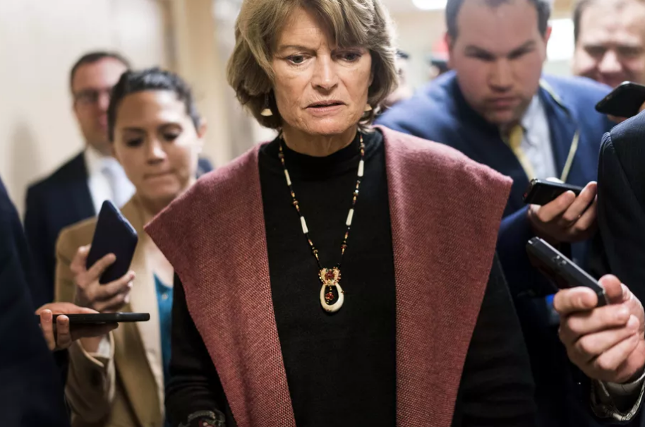 Sen. Lisa Murkowski (R-AK) speaks to journalists while walking to the Senate floor on Capitol Hill in Washington, DC, on January 24, 2019.