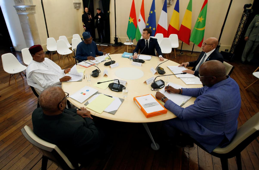 French President Emmanuel Macron, Mali's President Ibrahim Boubacar Keita, Burkina Faso's President Roch Marc Christian Kabore, Niger President Mahamadou Issoufou, Mauritania's President Mohamed Ould Cheikh El Ghazouani and Chad's President Idriss Deby attend a meeting during a summit on the situation in the Sahel region in the southern French city of Pau, France, January 13, 2020.