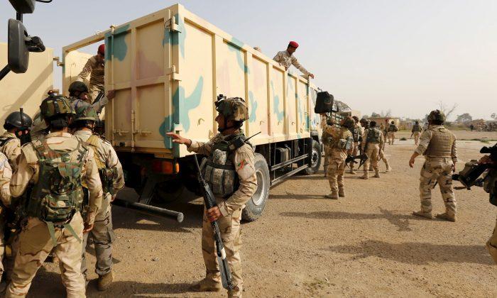 Iraqi security forces in a file photo near Camp Taji, Baghdad.