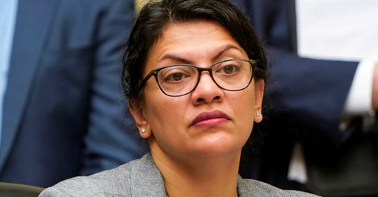 """Rep. Rashida Tlaib (D-MI) listens as Acting Homeland Security Secretary Kevin McAleenan testifies before the House Oversight and Reform Committee on """"Trump Administration's Child Separation Policy"""" on Capitol Hill in Washington, U.S., July 18, 2019"""