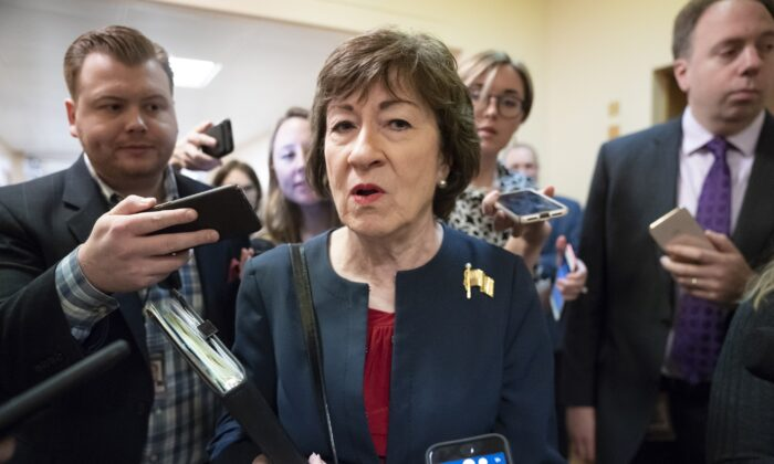 Sen. Susan Collins (R-Maine) is surrounded by reporters as she heads to vote at the Capitol in Washington on Nov. 6, 2019.