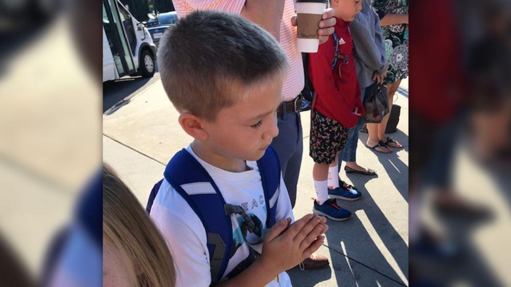 Ezra, age 6, prays before school in Chesterfield, VA.