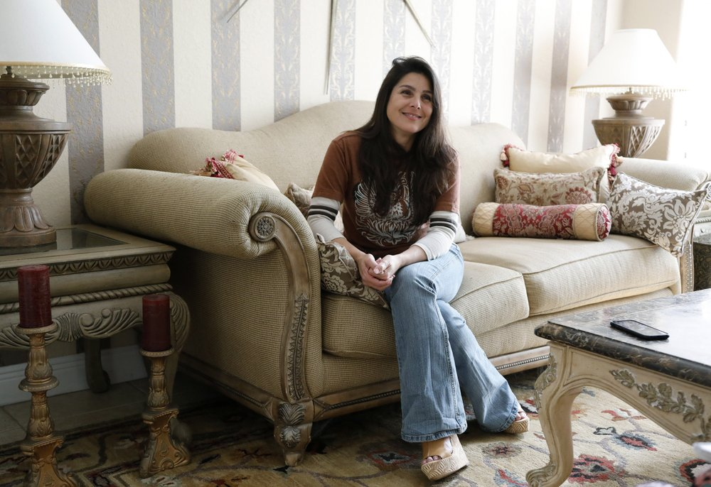 Judith Negron is interviewed at her home in Hialeah, Fla., Wednesday, Feb. 19, 2020.