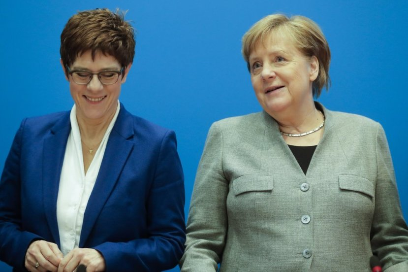 German Chancellor Angela Merkel, right, and CDU party chairwoman and Defense Minister Annegret Kramp-Karrenbauer, left, attend a party's board meeting at the headquarters in Berlin, Germany, Monday, Feb. 10, 2020. Angela Merkel's designated successor Annegret Kramp-Karrenbauer will quit her role as head of the Germany's strongest party in summer and won't stand for the chancellorship.