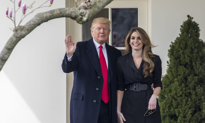 President Donald Trump poses with then White House communications director Hope Hicks
