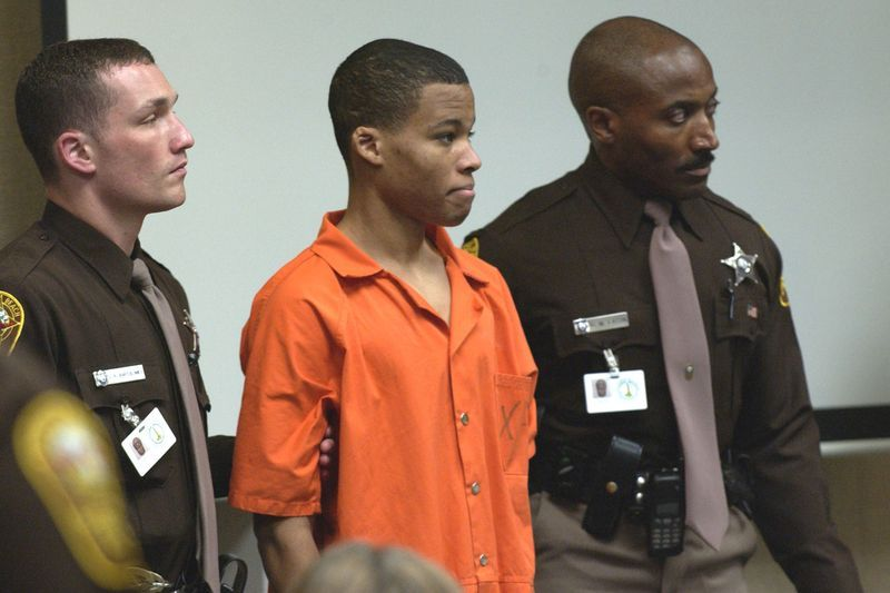 18-year old sniper suspect Malvo is surrounded by deputies as he is brought into court to be identified by a witness