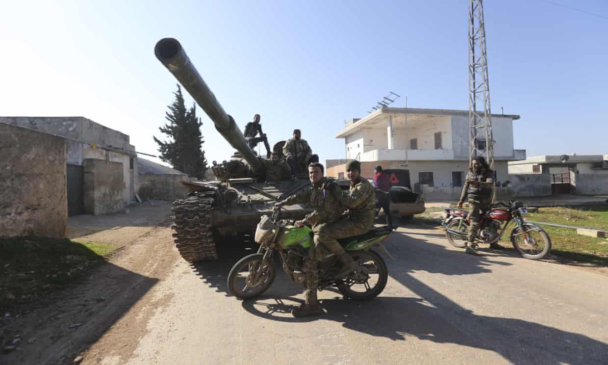 Syrian rebels in Saraqib. The loss of the town is a major setback for the Assad regime.
