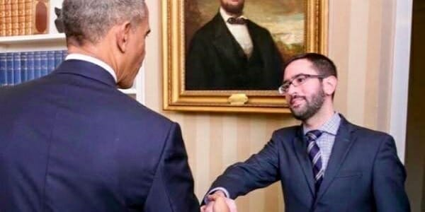 Ukraine specialist Eric Ciaramella poses for a photo with former President Barack Obama at the White House.