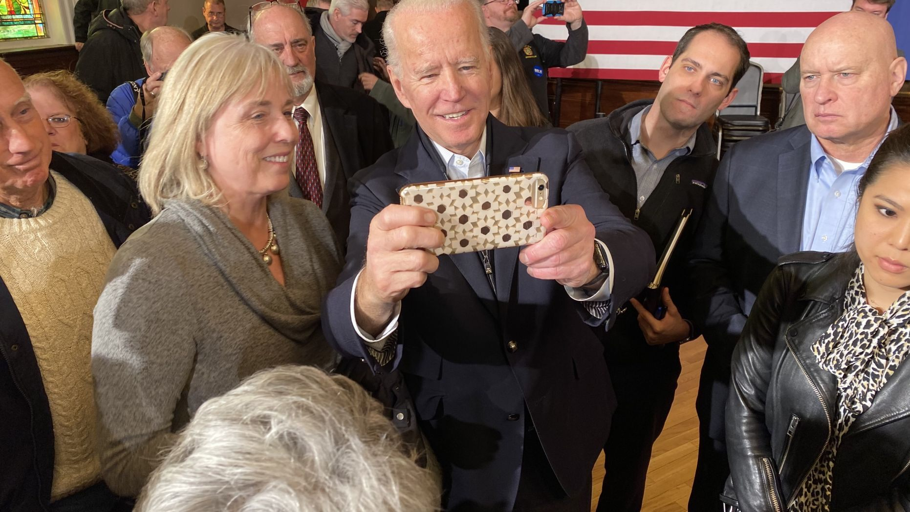 Former Vice President Joe Biden takes selfies with supporters during a campaign event in Somersworth, N.H. on Feb. 5, 2020