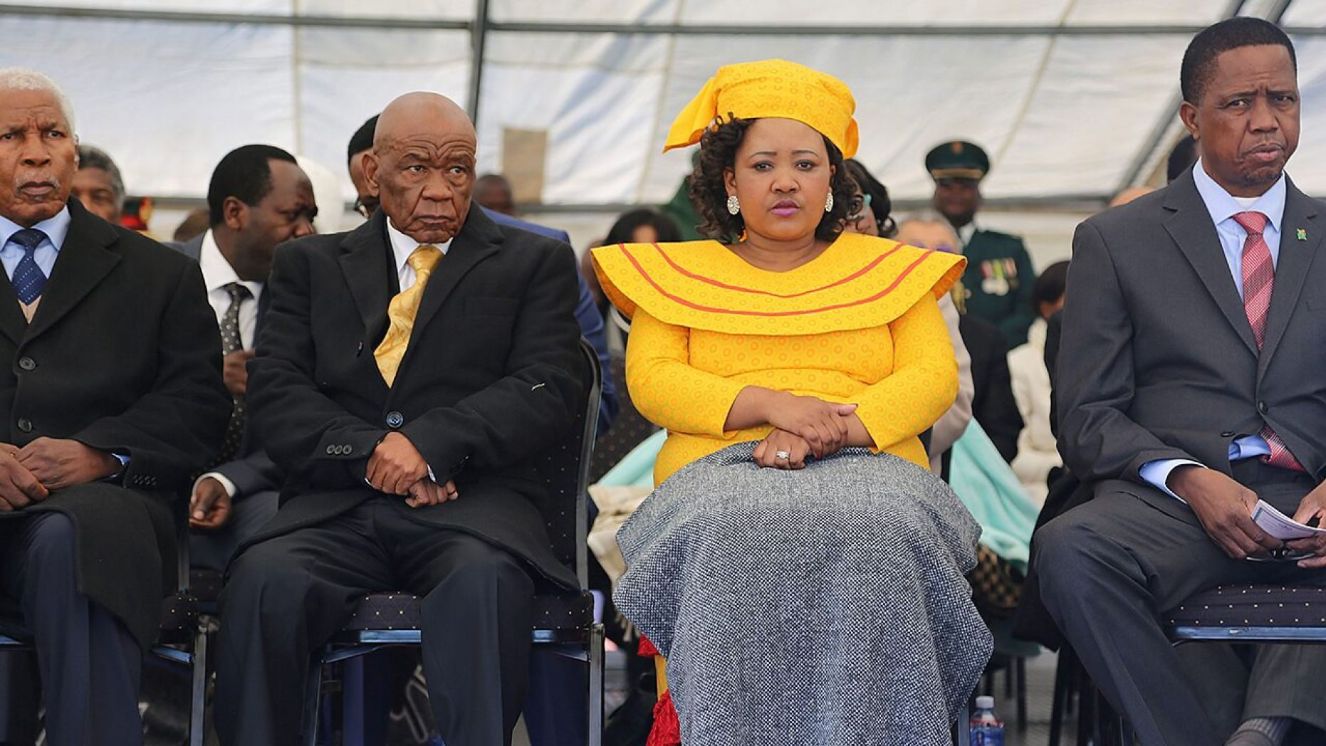 Newly appointed Lesotho prime Minister Thomas Thabane, left, leader of the All Basotho Convention (ABC) political party, his wife 'Ma Isaiah Ramoholi Thabane and Zambian President Edgar Lungu, right, attend Thabane's inauguration.