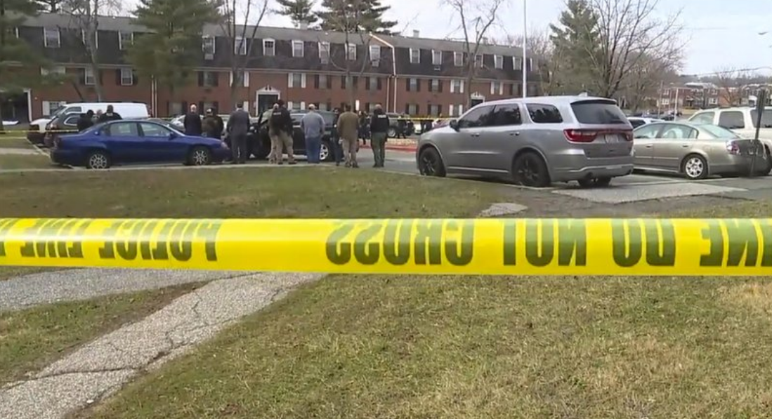 This image provided by WMAR-2 News shows emergency and law enforcement officials responding to the scene of a shooting,
