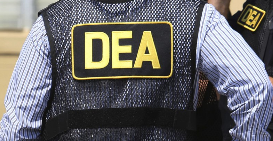 FILE - This June 13, 2016 file photo shows Drug Enforcement Administration (DEA) agents in Florida. On Friday, Feb. 21, 2020,