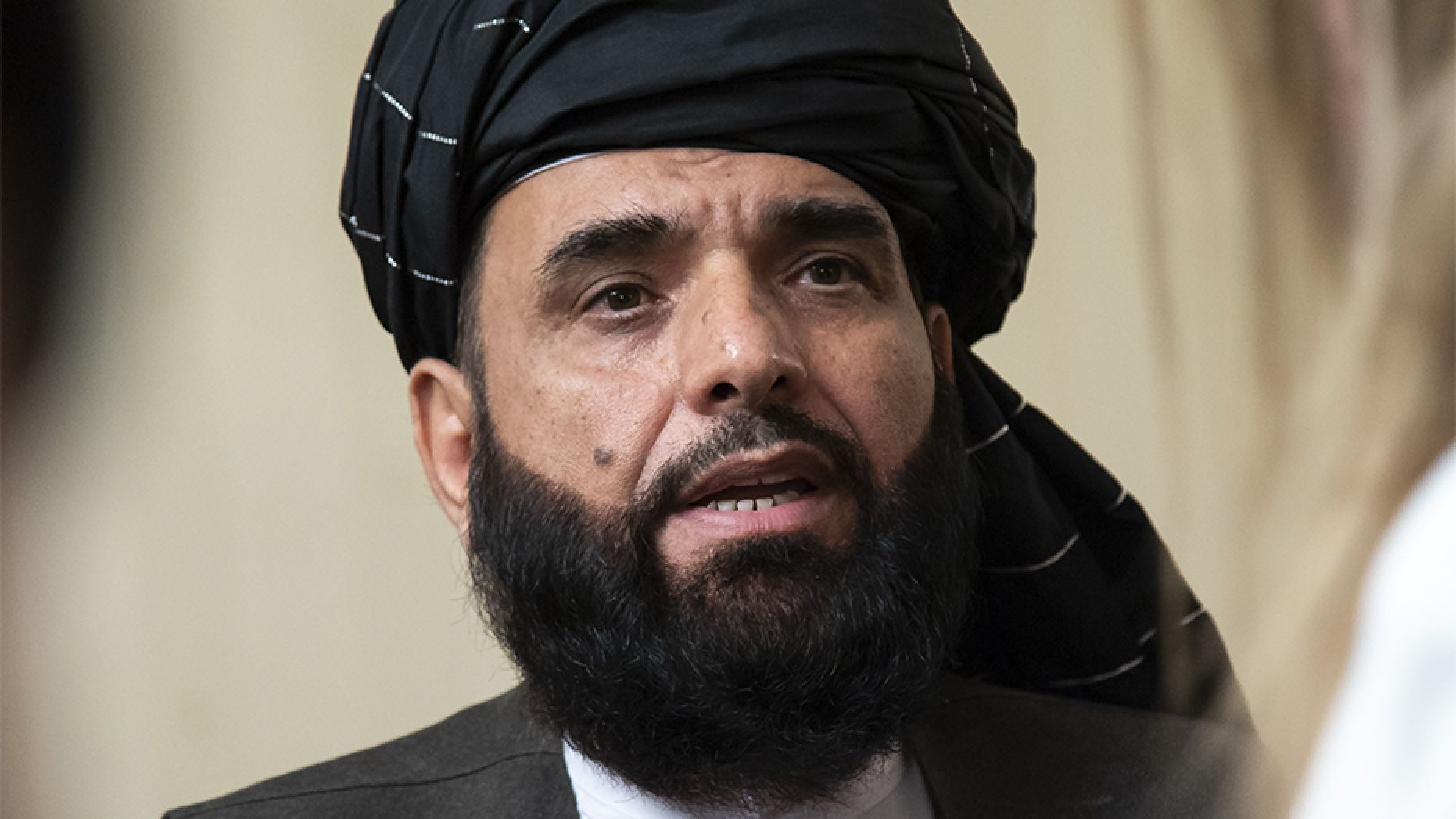 In this 2019 file photo, Suhail Shaheen, spokesman for the Taliban's political office in Doha, speaks to the media in Moscow, Russia.