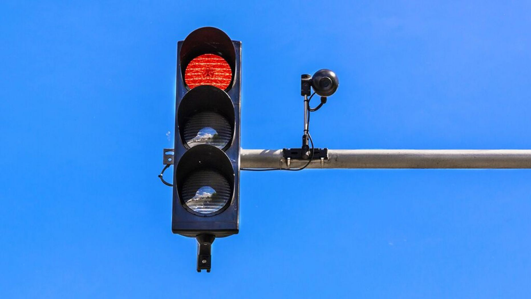 STOCK - A traffic light and a surveillance camera.