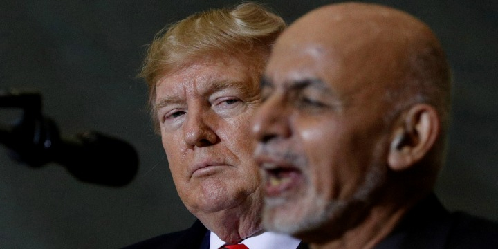 Afghanistan President Ashraf Ghani delivers remarks to US military personnel beside US President Donald Trump during a surprise visit at Bagram Air Base in Afghanistan,
