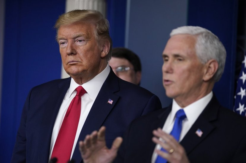 President Donald Trump listens as Vice President Mike Pence speaks during press briefing with the Coronavirus Task Force, at the White House, Wednesday, March 18, 2020,