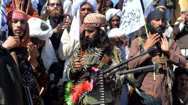 Taliban militants and villagers were pictured celebrating the peace deal on Monday.AFP