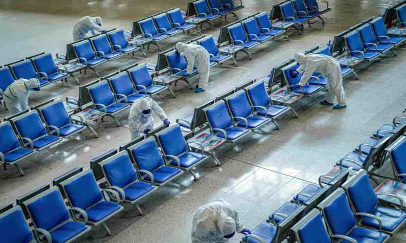 Workers disinfect a waiting area at Wuhan railway station, which has been closed since January.