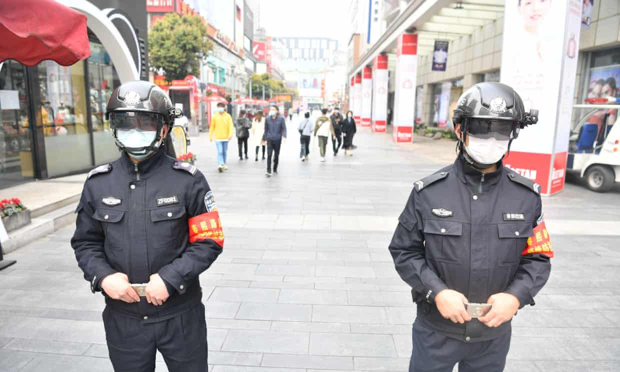 Police officers wearing smart helmets stand guard in Chengdu, Sichuan.