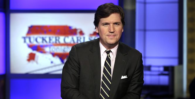 "FILE – In this March 2, 2017, file photo, Tucker Carlson, host of ""Tucker Carlson Tonight,"" poses for photos in a Fox News Channel studio in New York."